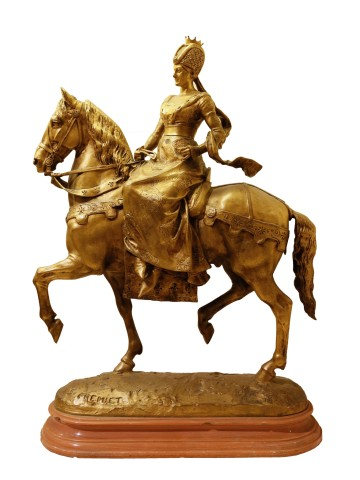 Woman riding on a horse