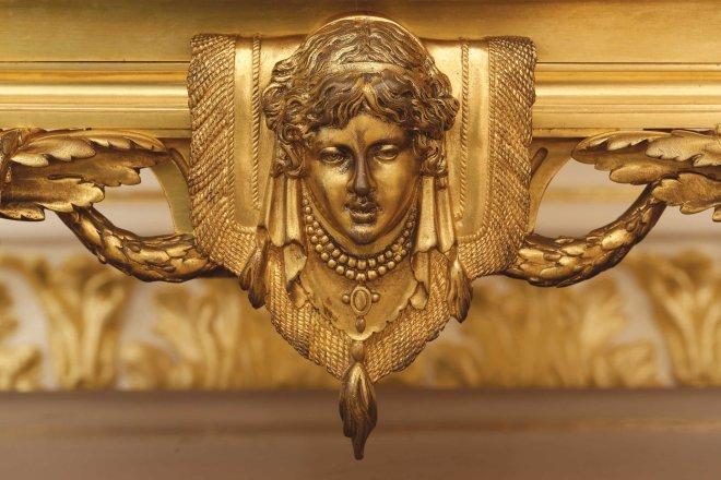 A gilt-bronze three-piece clock garniture