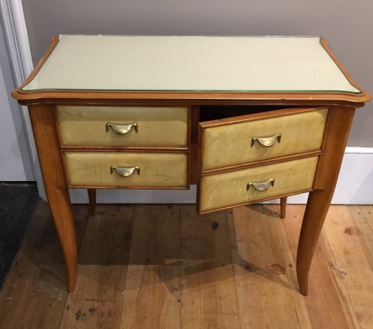 A Pair of Italian Vellum and Fruitwood Cabinets circa 1940 Each with a cupboard and two small drawers, the tops lined in fabric under glazed covers