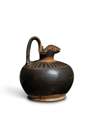 Corinthian black-glaze oinochoe with trefoil lip and lid, c.late 7th-early 6th century BC