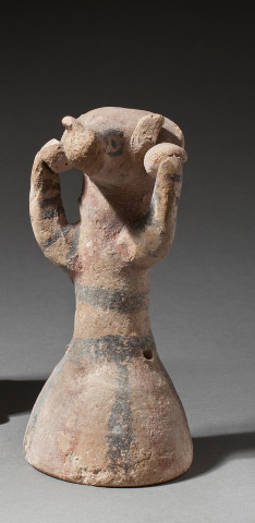 Cypriot Bichrome Ware figure of a ram headed votary, Early Iron Age, 750-600 BC