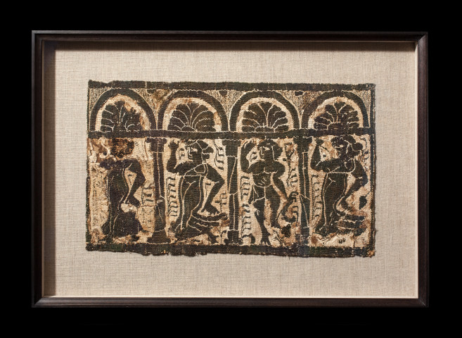 Coptic tunic fragment showing bacchanalia, Byzantine period, c.4th century AD