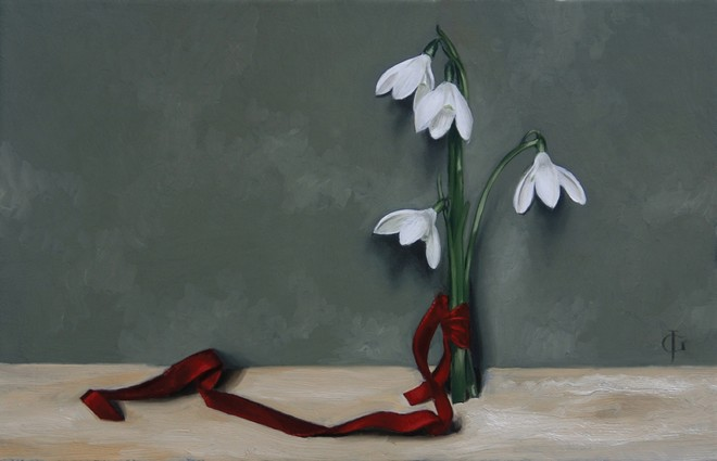 Posy of Four Snowdrops Tied with a Red Ribbon