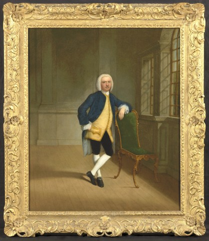 Gentleman leaning on a giltwood chair in an interior by a window