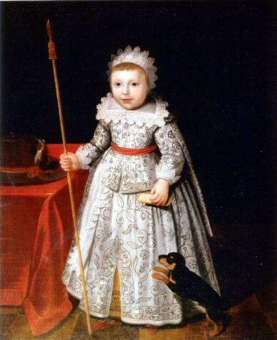 Portrait of a little boy with his pet dog, standing by a table with a velvet red tablecloth. He is dressed in a richly embroidered surcoat and doublet, and holds a toy lance in his right hand and a paper in his left. A large hat with a red feather rests o