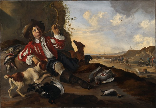 A youthful sportsman reclining on a bank, blowing a salute to the game on his hunting horn, his spaniel by his side with various birds including a brace of English partridge, and a black grouse; a beach with elegant figures on horseback beyond