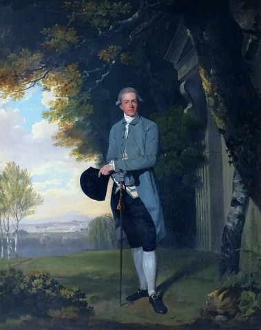 Portrait of Thomas Grimston of Kilnwick Hall (1753-1821) standing by a classical portico in an extensive wooded landscapes
