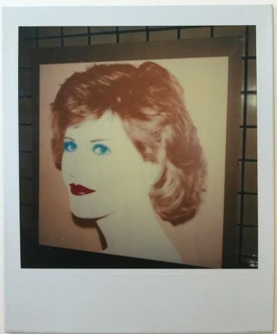Unique polaroid portrait of unidentified woman.