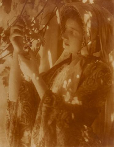 Minna Keene, Untitled [Portrait of a woman holding grapes], circa 1900