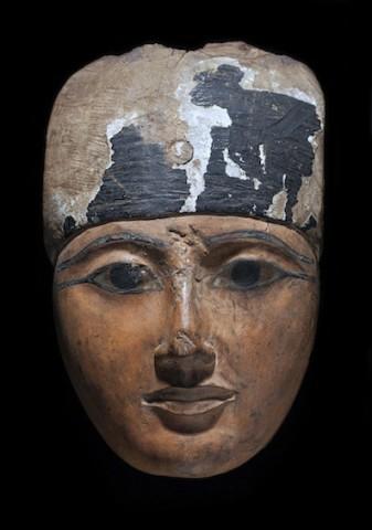 An Egyptian wood sarcophagus mask