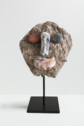Peter Liversidge Effigy (4), 2017 Found stones and shell, hot glue and metal stand 14 x 12 x 5cm (excluding stand)
