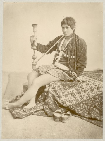 Antoin Sevruguin, A Persian women with a water pipe, Late 19th Century or early 20th Century