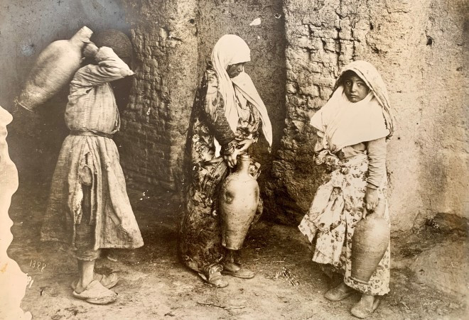 Antoin Sevruguin, Three girls collection water from a water cellar (sardab) in Tehran, Late 19th Century or early 20th Century