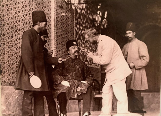 Antoin Sevruguin, Barber dyeing the mustache of Mozaffar ad-Din Shah Qajar, Late 19th Century