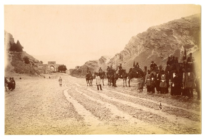 Antoin Sevruguin, Rider company leaves Shiraz with the Koran Gate in the background, Late 19th Century