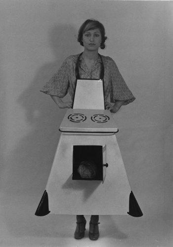 Birgit Jürgenssen  Housewives' Kitchen Apron, 1974-75  Black and white photograph  Unframed: 40.5 x 30.4 cm / 16 x 12 ins  Framed: 66.5 x 51.5 cm / 26 1/8 x 20 1/4 ins