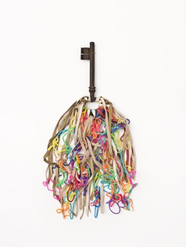 Sheila Hicks  Joie de Vivre, 2013  Signed, dated and titled on verso  Latex (rubber), leather, iron key  Unframed: 19 x 34 x approx. 1 cm / 7 1/2 x 13 3/8 x approx. 3/8 ins Framed: 41.5 x 45.5 x 2.5 cm / 16 3/8 x 17 7/8 x 1 ins