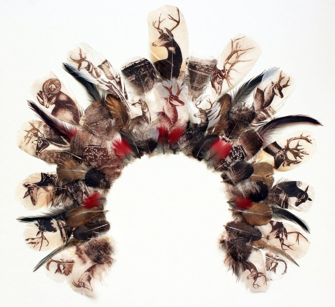<span class=&#34;title_and_year&#34;><em>Deer Stalker's Headdress I</em>, 2013<span class=&#34;title_and_year_comma&#34;>, </span></span><span class=&#34;medium&#34;>etching and feathers on archival board<span class=&#34;medium_comma&#34;>, </span></span><span class=&#34;dimensions&#34;>20 1/2 x 22 1/8 in</span>