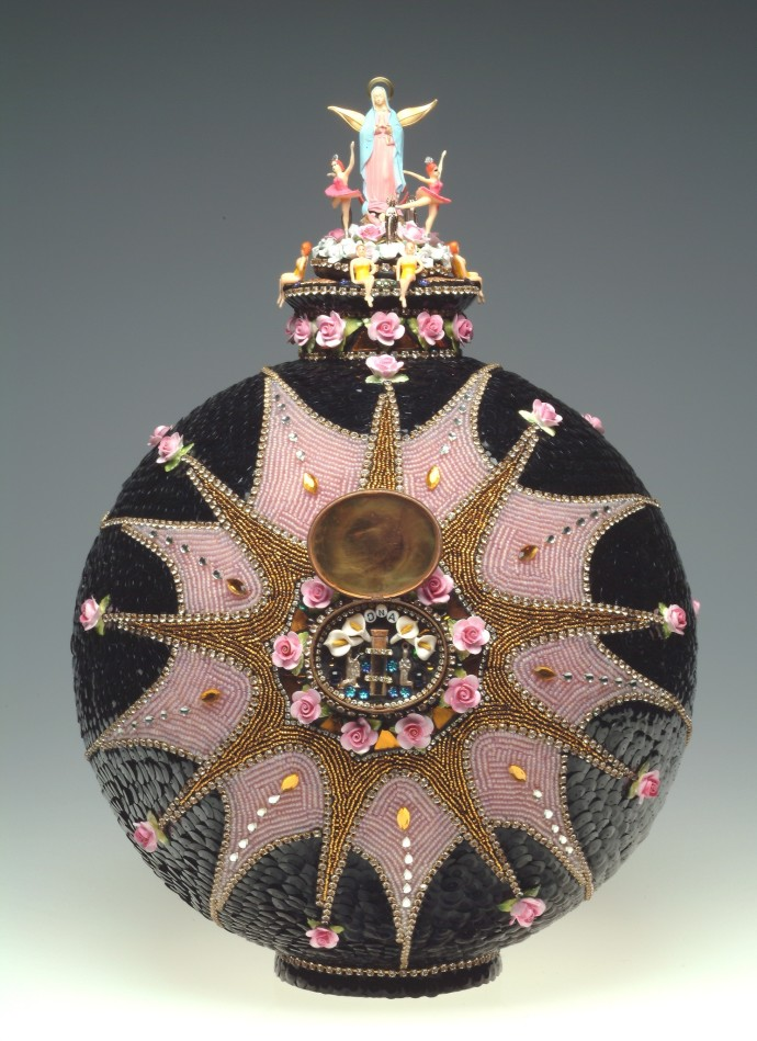 <p><b>Nancy Josephson, </b><i>Pink Reliquary Cremation Urn</i>, 2012-2013, mixed media including sequins, vintage and contemporary glass beads, scrabble tile letters, and plastic Mary statue, 53.3 x 38.1 cm, 21 x 15 in</p>