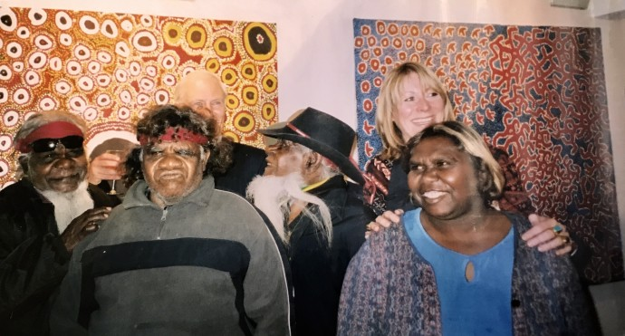 The Right Honorable Richard Alston, Australian High Commissioner and Rebecca Hossack with Spinifex Artists at the Ilkurlka show at the Rebecca Hossack Art Gallery
