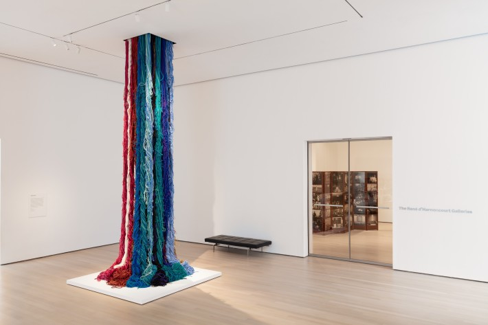 """Sheila Hicks, Pillar of Inquiry/Supple Column, 2013-14. Acrylic fibre, 204 x 48 x 48 inches (variable). The Museum of Modern Art, New York. Gift of Sheila Hicks, Glen Raven Inc., and Sikkema Jenkins and Co. Installation view of the exhibition """"Surrounds: 11 Installations,"""" 21 October 2019 - 5 January 2020. Digital Image © 2019 The Museum of Modern Art, New York. Photo by Denis Doorly"""