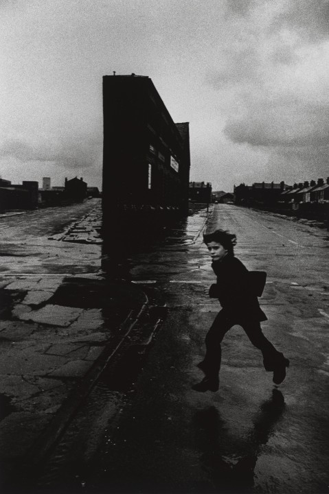 Boy Jumping over Puddle, Liverpool, 1970s © Don McCullin