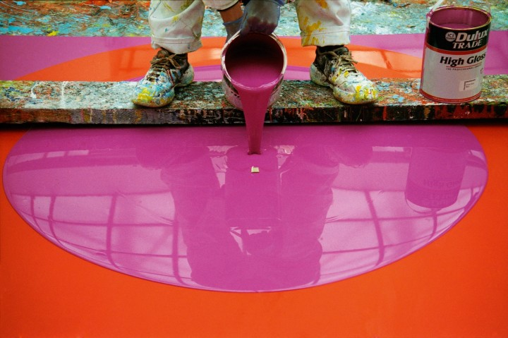 The artist working on Poured Painting: Magenta, Orange, Magenta, 1999