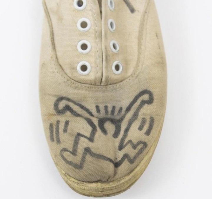 "<span class=""artist""><strong>Keith Haring</strong></span>, <span class=""title""><em>Signed and Illustrated Plimsoles</em>, (circa) Early 1980s</span>"