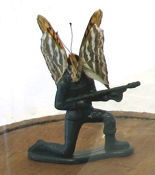 Abby Goodman Soldierfly Kneeling Butterfly, plastic toy , glass bell jar with wood base with standing figure
