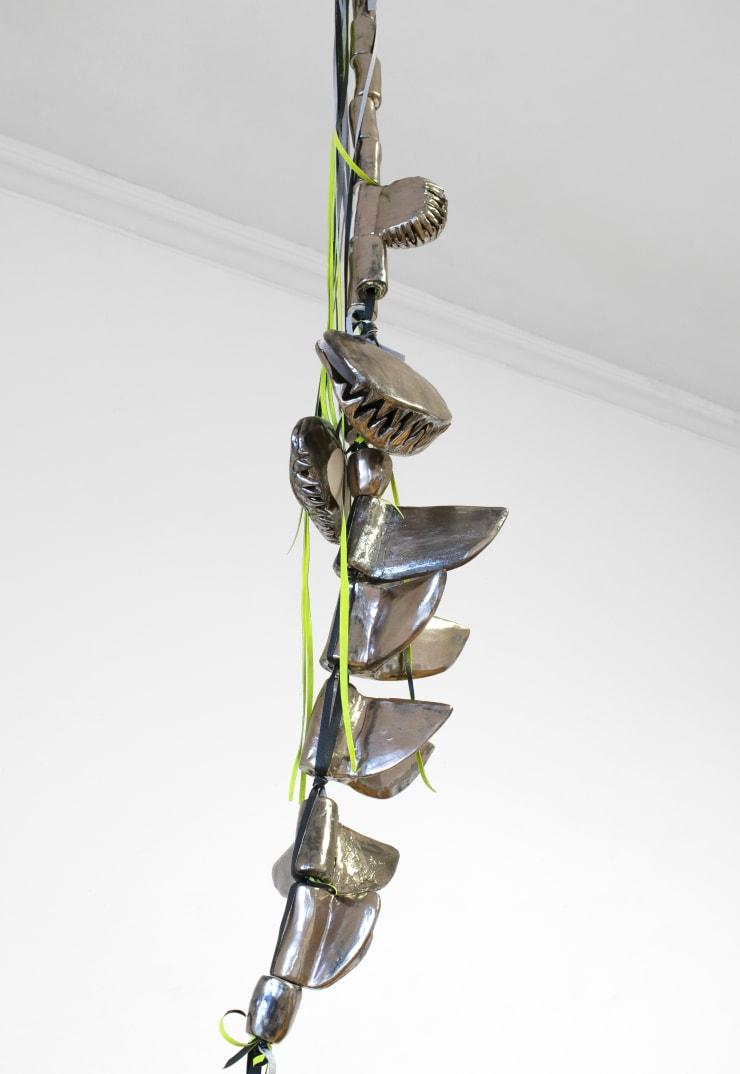 Céline Struger Tender Prey, 2019 Clay, artificialleather 300 x 35 x 30cm