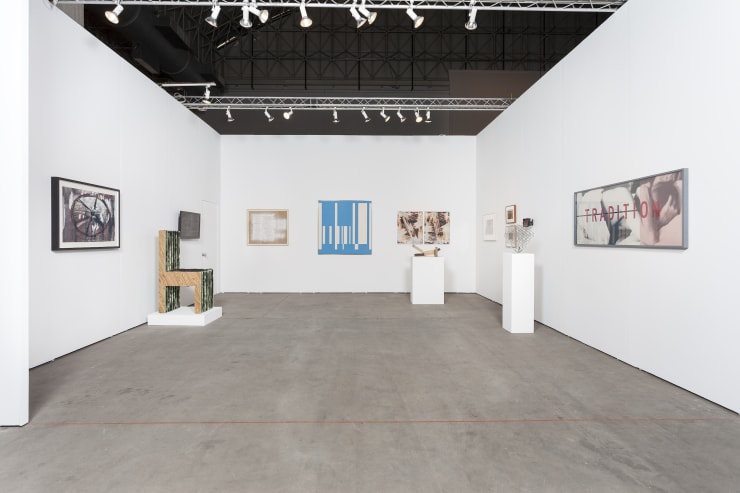 Art fair booth with photographic works by Anselm Kiefer, Richard Galpin and Barbara Kruger, plus several paintings and sculptures by Anselm Kiefer and Joel Shapiro.