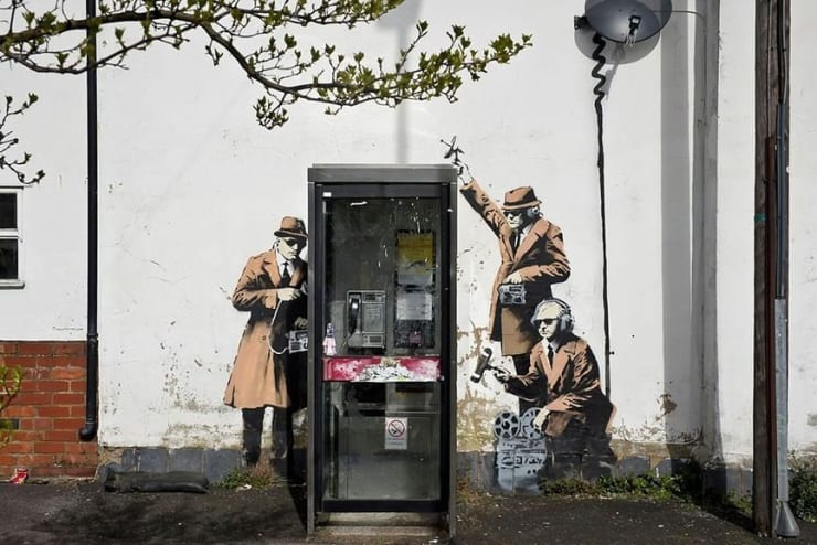 Banksy Artwork Spy Booth Valued at Million Pounds is Now Worth Nothing because it has been vandalized.