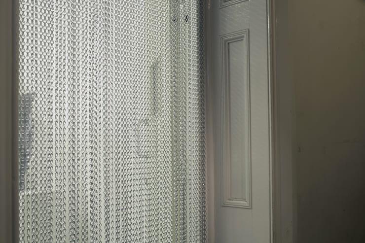 Susie Green, OOOOOOOO, 2015, Aluminium curtain fly screen, mixed media