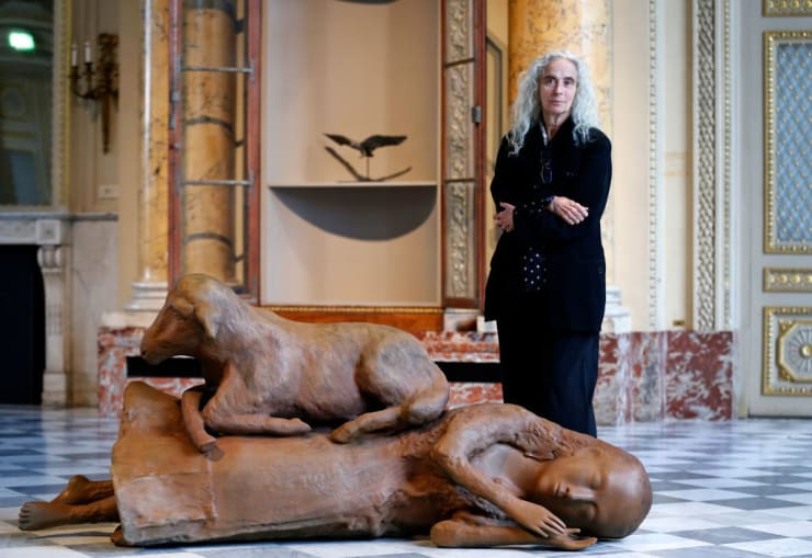 Kiki Smith poses next to her artwork at the 'Monnaie de Paris' on October 17, 2019 in Paris, France. Photo by Chesnot/Getty Images.