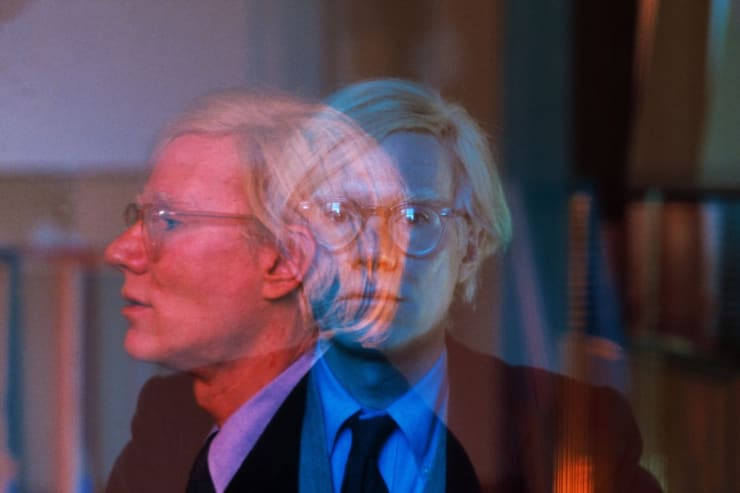 """Thomas Hoepker. Double exposure of Andy Warhol in his """"Factory"""" at Union Square, Manhattan, New York City, USA. 1981. © Thomas Hoepker 
