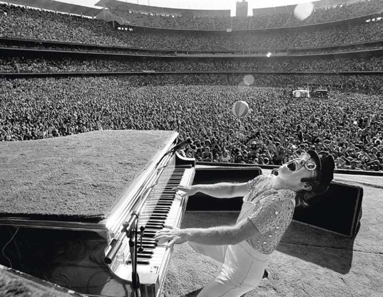 Terry O'Neill - Elton John performing at Dodger Stadium in Los Angeles, October