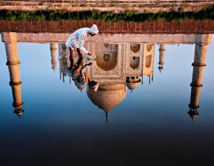 Steve McCurry - Man and Taj Reflection, Agra, India