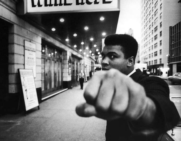 Bob Gomel - Boxing champion Muhammad Ali posing in front of the Alvin Theater during production of play