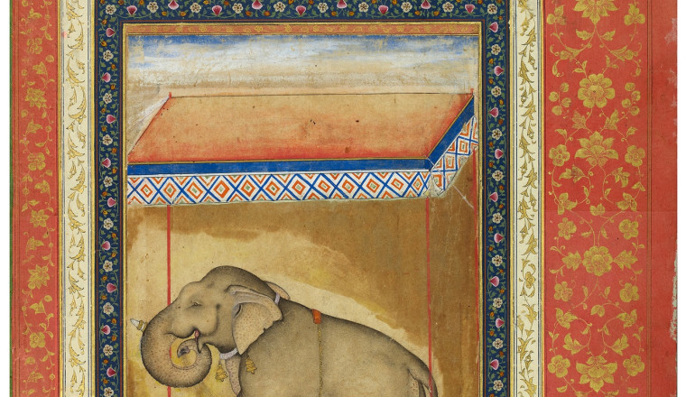 """<div class=""""title""""><em>A Tethered Favourite Elephant with an Inscription naming Kanak Singh</em></div><div class=""""year""""> Mughal, 1590s</div><div class=""""medium"""">Opaque pigments and gold on paper in an 18th century pink album border</div><div class=""""dimensions"""">Painting: 23.8 x 16.5 cm  Folio: 47.9 x 32 cm</div>"""