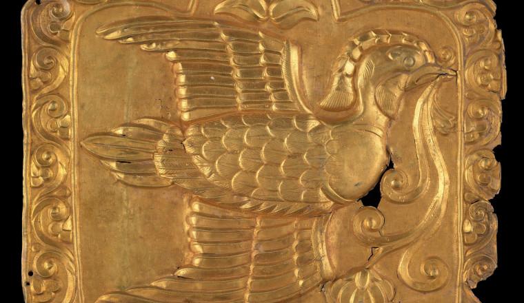 "<div class=""title""><em>Silver-gilt repoussé plaque depicting a mandarin duck in flight</em></div><div class=""year""> Central Asia, 7th – 9th century</div><div class=""medium"">Repoussé silver-gilt<br />18 x 19.5 cm</div>"
