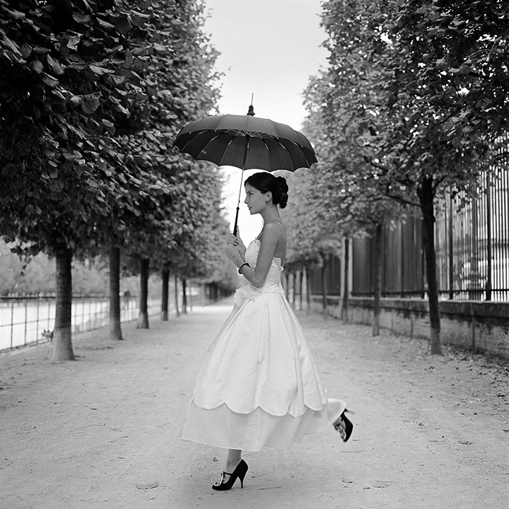 Rodney Smith, Mira Skipping with Umbrella, Paris, France, 2007