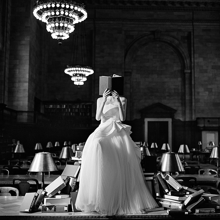 Rodney Smith, Flynn Reading on a Pile of Books, New York, New York, 2012