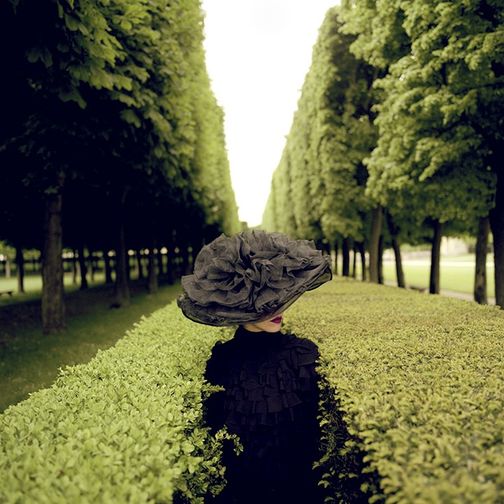 Rodney Smith, Woman with Hat Between Hedges, Parc de Sceaux, France, 2004