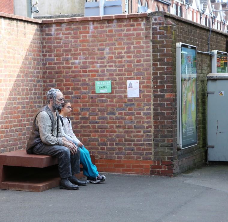 """Seated Man"" on Platform 1 of Woking Station"
