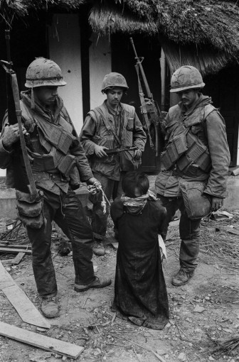 <em>US Soldiers Tormenting a Civilian in the Old City of Hue During the Offensive, Tet, Hue</em>, 1968