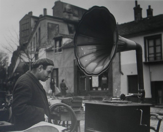<span class=&#34;title&#34;>Man at Flea Market with Vinyl Player, France<span class=&#34;title_comma&#34;>, </span></span><span class=&#34;year&#34;>c.1950</span>