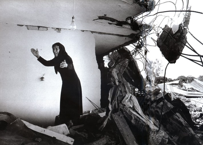 "<span class=""title"">A Palestinian Woman Returning to the Ruins of her House, Sabra, Beirut<span class=""title_comma"">, </span></span><span class=""year"">1982</span>"