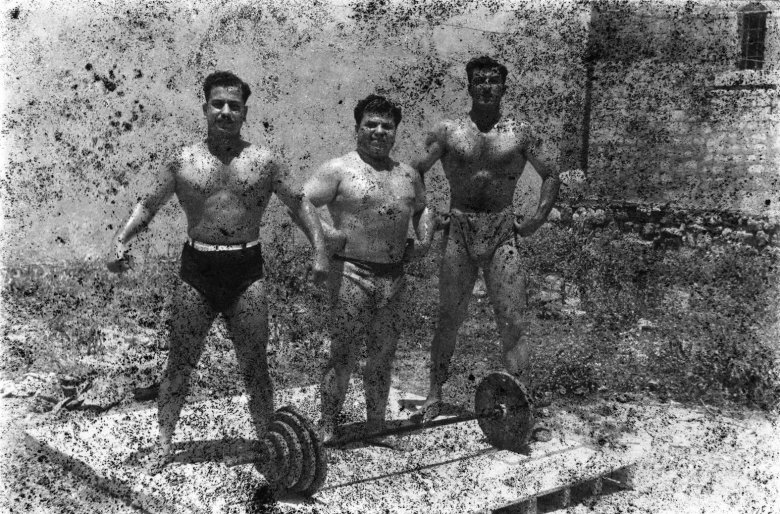 Bodybuilders, Printed From A Damaged Negative Showing From Left To Right: Hassan El Aakkad, Munir El Dada And Mahmoud El Dimassy In Saida, 1948