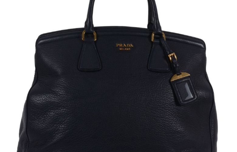 Dreweatts & Bloomsbury Auctions: Prada, a dark blue deerskin leather handbag, with twin rolled leather handles, the interior with three zip compartments and three pockets, 41 x 30 x 17cm, with a Prada dust bag and ID tag £100-150