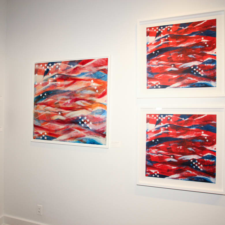The original painting next to two of the limited edition prints of Stars and Stripes.